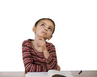 Girl thinking during homework Royalty Free Stock Photography