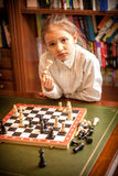 Girl thinking on move at chess Stock Photo