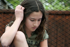 Girl thinking outdoors Royalty Free Stock Photos