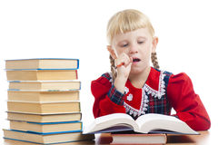 Girl thinking over the homework Royalty Free Stock Photography