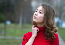 Girl thinking. Portrait of an attractive beautiful pretty cute young caucasian successful cheerful thinking and looking up woman (girl, female, person, model) in Royalty Free Stock Photo