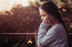 Girl thinking portrait on balcony. Autumn time Royalty Free Stock Photography