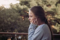 Girl thinking portrait on balcony. Autumn time Royalty Free Stock Image