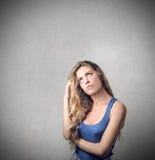 Girl thinking of something Stock Photography