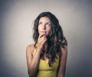 Girl thinking of something Royalty Free Stock Images