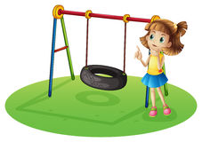 A girl thinking beside a swing Stock Photo