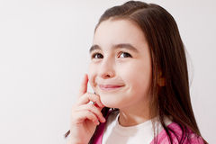 Girl thinking to a solution. And smiling Stock Photos