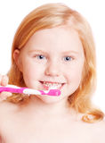 Girl thinking while washing teeth Stock Images