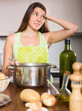 Girl thinking what to cook Royalty Free Stock Photos