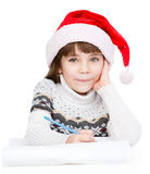 Girl thinking what to write in a letter to Santa Claus. isolated Stock Images