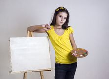 The girl thinks that she draw Royalty Free Stock Photo