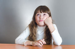 Girl thinks. Royalty Free Stock Photos