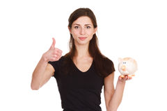 Girl thinks about saving money with moneybox Stock Photography