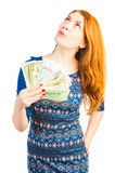 Girl thinks to spend money Stock Photo