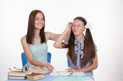 Girl thought doing homework Stock Photo