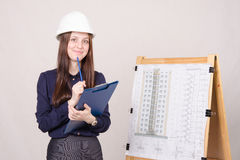 The girl thought project architect Royalty Free Stock Photography