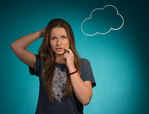 Girl thoughtful and surprised. Nearby speech bubble. Royalty Free Stock Photography