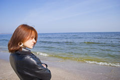 Girl thoughtfully looking into the sea distance. Picture of a girl thoughtfully looking into the sea distance Royalty Free Stock Photography