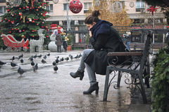 Girl thoughtfully sitting on the bench. Stock Photography