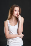 The girl in thoughtfulness touches lips.  Royalty Free Stock Image