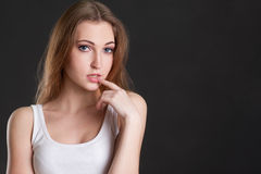 The girl in thoughtfulness touches lips. Thewomen in thoughtfulness touches lips Royalty Free Stock Images