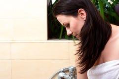 Girl in thr bathroom Stock Photos