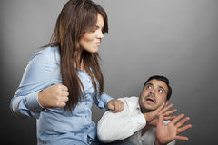 Girl threatens with a fist his boyfriend royalty free stock photo