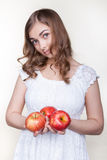 Girl with three apples in their hands Royalty Free Stock Photography