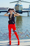 Girl in a three-cornered hat on the river bank. Girl in pirate hat posing on the river against the background of the ship WIG Royalty Free Stock Photos