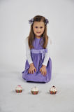 Girl and Three Cupcakes Stock Photo