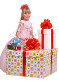 Girl and three gift boxes. Isolated Stock Image