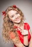 Girl and three hearts Stock Photos