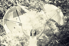 Girl with three umbrellas Stock Images