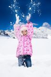 Girl throw snow Royalty Free Stock Photos
