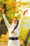 Girl throwing autumn leaves in the air Royalty Free Stock Photos