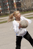 Girl throwing the ball Royalty Free Stock Images