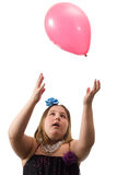 Girl Throwing Balloon Stock Images