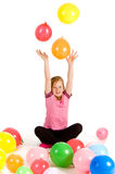 Girl throwing balloons Stock Photo