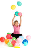 Girl throwing balloons Stock Image