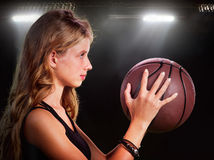 Girl throwing basketball in gym. Royalty Free Stock Photo
