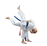 The girl is throwing boy the throw of judo Royalty Free Stock Image