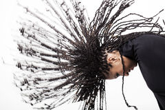 Girl throwing down her braids Royalty Free Stock Photography