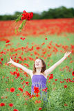 Girl throwing flowers into the air Royalty Free Stock Images