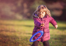 Girl throwing frisbee Stock Images