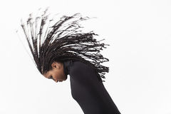 Girl throwing her braids Royalty Free Stock Photography