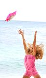 Girl throwing her hat up on sea background Stock Photography