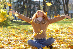 Girl throwing  leaves Stock Images
