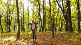 Girl throwing leaves in Autumn in slow motion stock video footage