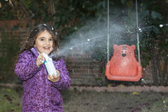 Girl throwing out snow Stock Images