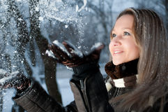 Girl throwing snow Royalty Free Stock Images